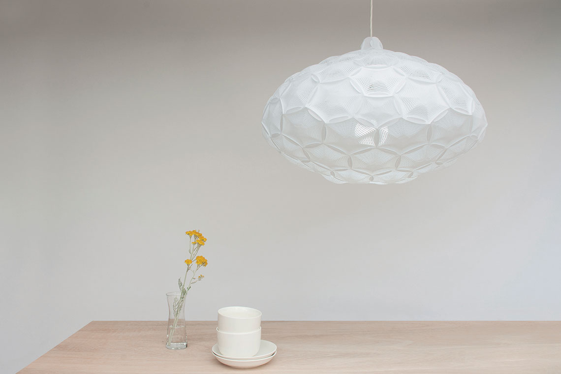 Airy pendant lighting collection 24d studio large cloud like white airy pendant lamp designed by 24d studio hangs over a wood aloadofball Image collections